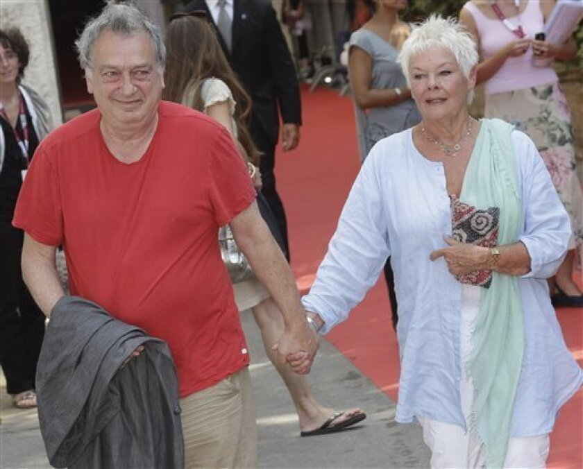 Director Stephen Frears, left, and actress Judi Dench arrive for the press conference of the movie 'Philomena' at the 70th edition of the Venice Film Festival held from Aug. 28 through Sept. 7, in Venice, Italy, Saturday, Aug. 31, 2013. (AP Photo/Domenico Stinellis)