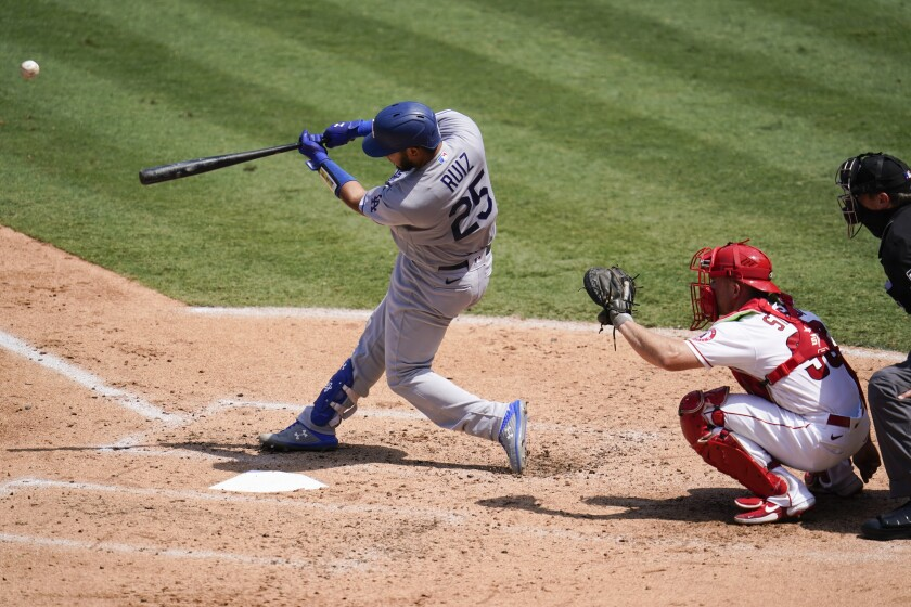 Los Angeles Dodgers Keibert Ruiz hits a solo home run during the third inning of a baseball game against the Los Angeles Angels Sunday, Aug. 16, 2020, in Anaheim, Calif. (AP Photo/Marcio Jose Sanchez)