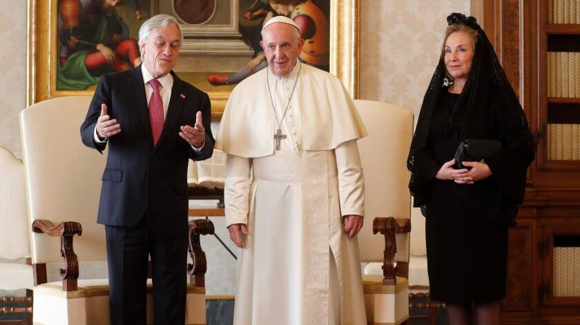 Pope Francis poses with Chile's President Sebastian Pinera and his wife, Cecilia Morel, during a private audience at the Vatican on Oct. 13, 2018.
