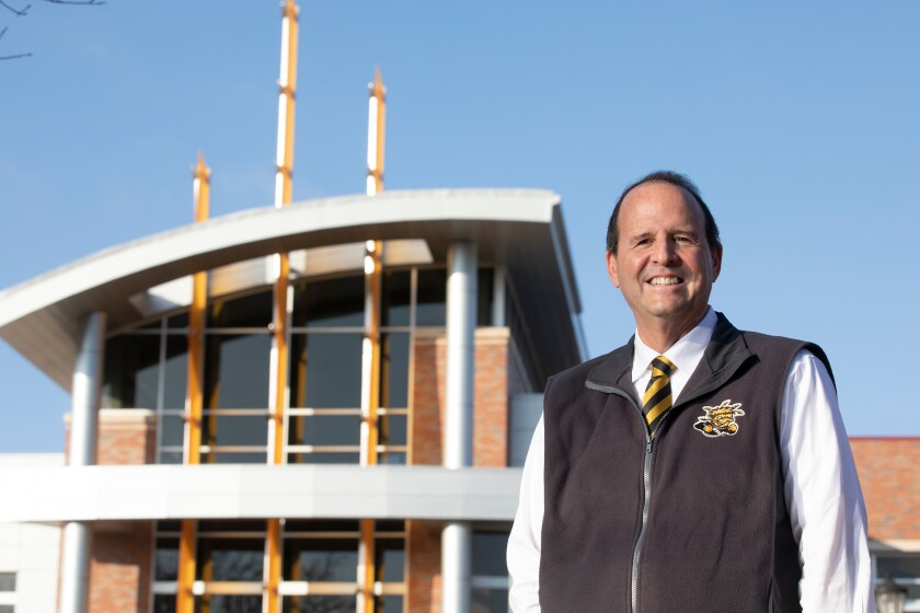In this Dec. 6, 2019 photo Wichita State University's President Jay Golden poses for a photo on campus in Wichita, Ks.