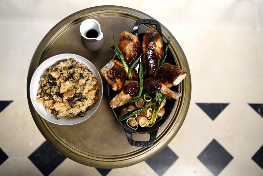 LOS ANGELES, CA-January 14,2019: Whole-Roasted Chicken: Lemon parmesan stuffing with tomato rice, sc