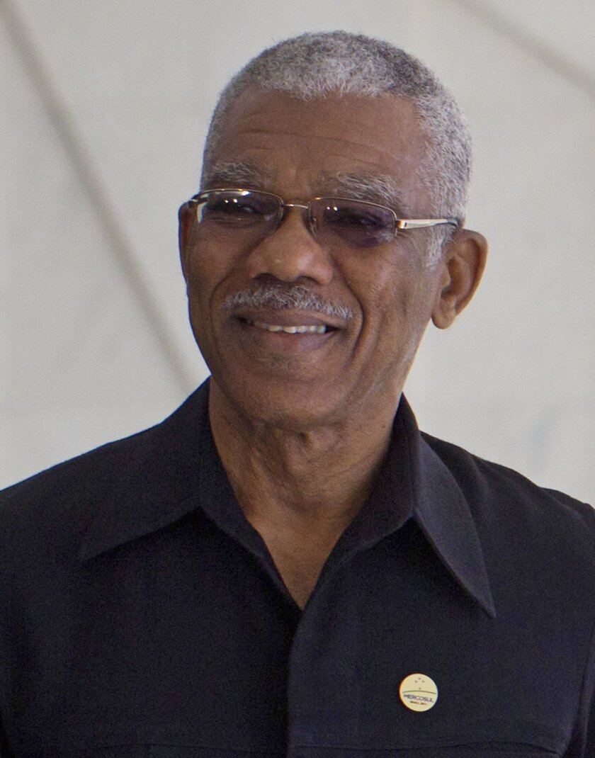 """FILE - In this July 17, 2015 file photo, Guyana's President David Granger poses for a photo in Brasilia, Brazil. On Tuesday, Sept. 22, 2015, Granger has accused Venezuela of deploying troops to a contested border region in what he called a """"dangerous"""" escalation of a long-running dispute between the two South American nations. (AP Photo/Joedson Alves, File)"""