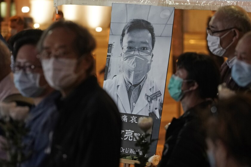 People attend a vigil for Chinese Dr. Li Wenliang, who was reprimanded for warning about the outbreak of the new coronavirus, in Hong Kong in early February.