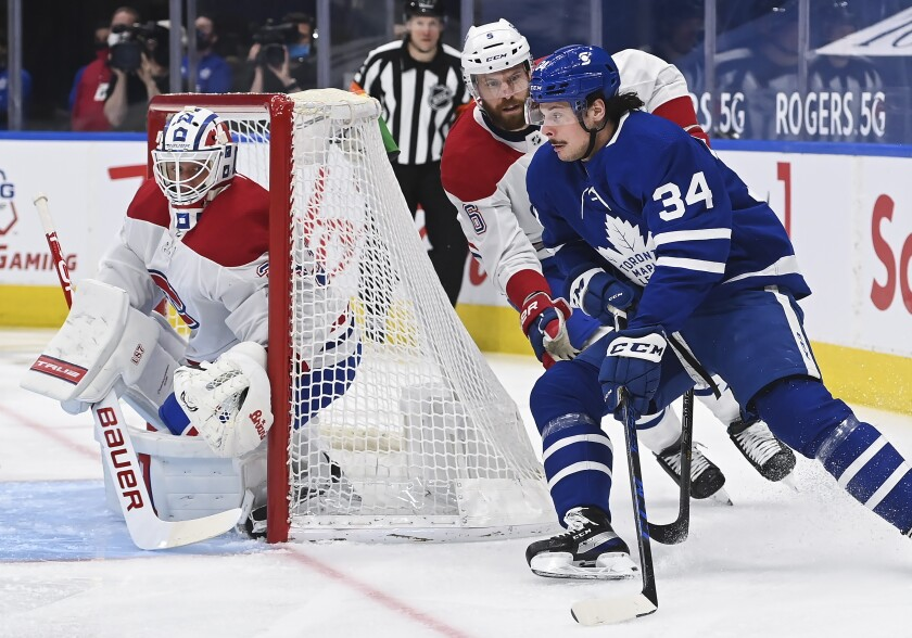 FILE - In this April 7, 2021, file photo, Toronto Maple Leafs forward Auston Matthews (34) scores on a wraparound past Montreal Canadiens goaltender Jake Allen (34) as Canadiens defenseman Shea Weber (6) pursues during the first period of an NHL hockey game in Toronto. The rear-view mirror is something Toronto stars Matthews and Mitch Marner are doing their best to ignore as the NHL season approaches. (Nathan Denette/The Canadian Press via AP, File)