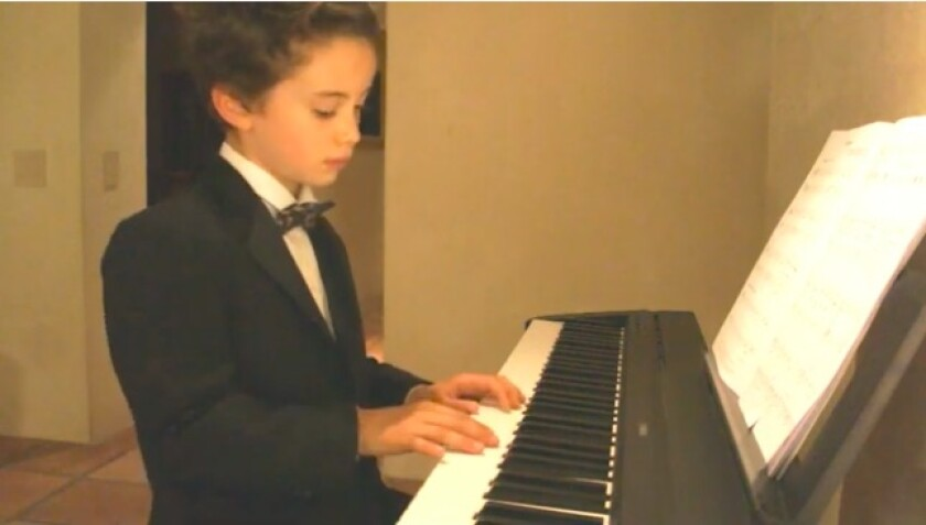 R. Roger Rowe kindergartner James Burnell performs in the virtual talent show.