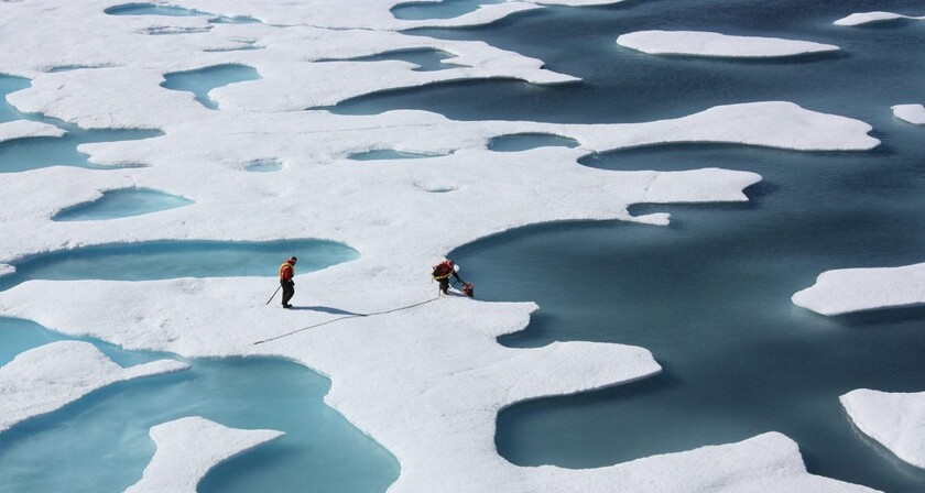 Coast Guard crew members at work on a mission with NASA to study changing Arctic conditions. Exxon has used such studies to help plan future operations.
