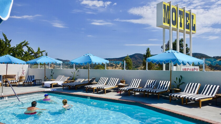 Guests hang out at the pool at the newly reopened Skyview Los Alamos, a rustic-chic home base for wine tasters in Santa Barbara wine country.