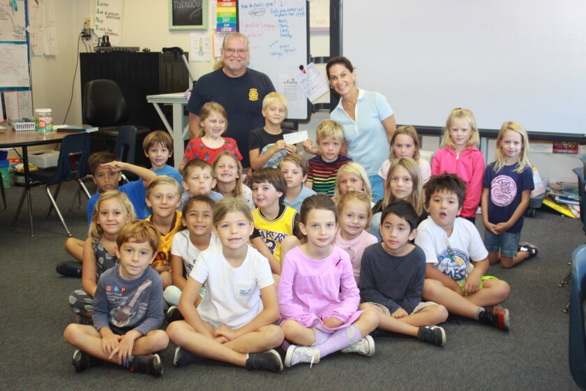 Kristi Nelson's Bird Rock Elementary first-grade class, with Torrey Pines Rotary Club president Henri Migala and a check for $500.