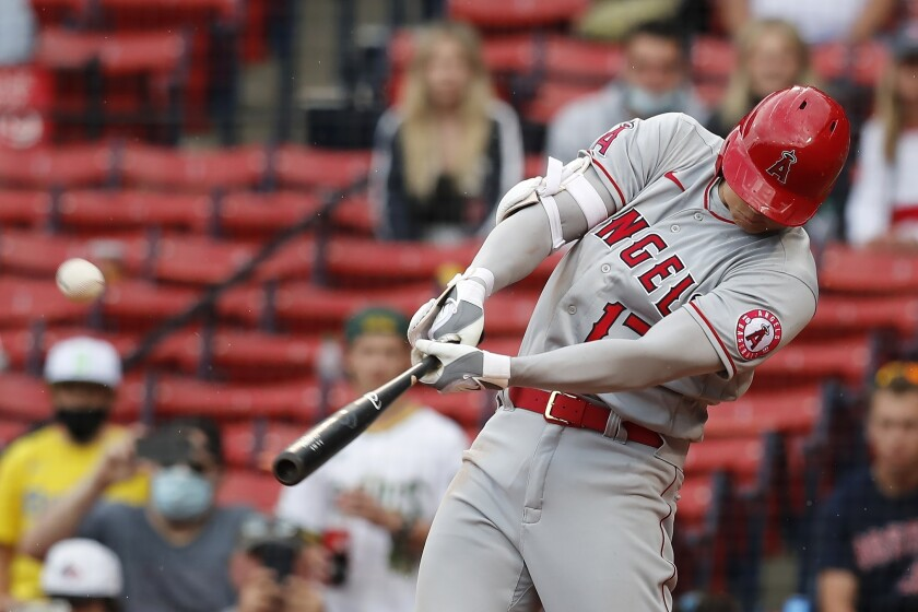 Los Angeles Angels' Shohei Ohtani hits a two-run home run during the ninth inning of a baseball game against the Boston Red Sox, Sunday, May 16, 2021, in Boston. (AP Photo/Michael Dwyer)