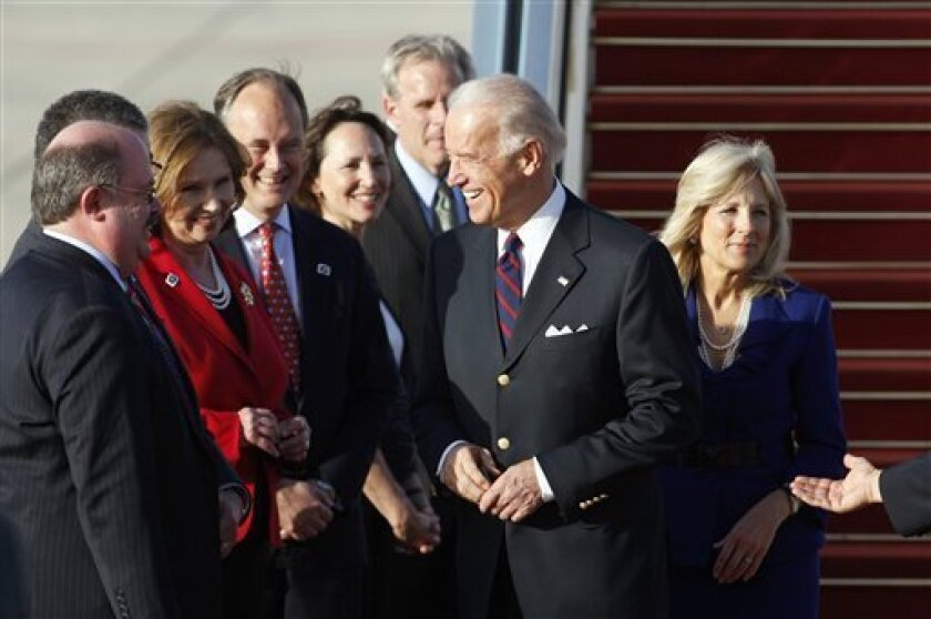 U.S. Vice President Joseph Biden, second from right, and his wife Dr. Jill Biden, right, are welcomed upon their arrival at Ben Gurion airport, near Tel Aviv, Israel, Monday, March 8, 2010. Biden arrived in Israel Monday, the first leg of a five-day tour of the Middle East. Biden's trip is the high