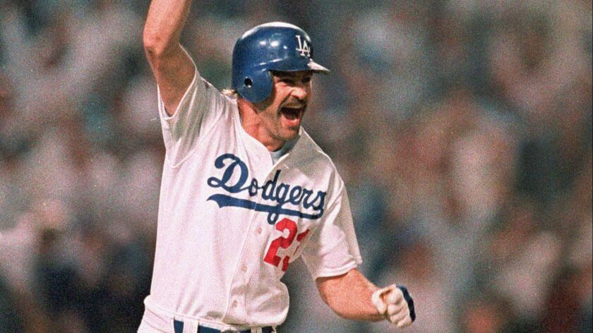 The Dodgers' Kirk Gibson rounds the bases after hitting a game-winning two-run home run in the bottom of the ninth inning to beat the Oakland Athletics in Game 1 of the 1988 World Series.