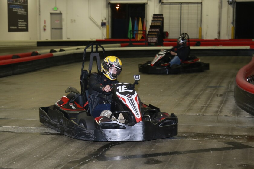 Blind daters Ellie (front) and Chris started their evening together go-kart racing at K1 Speed in Barrio Logan.