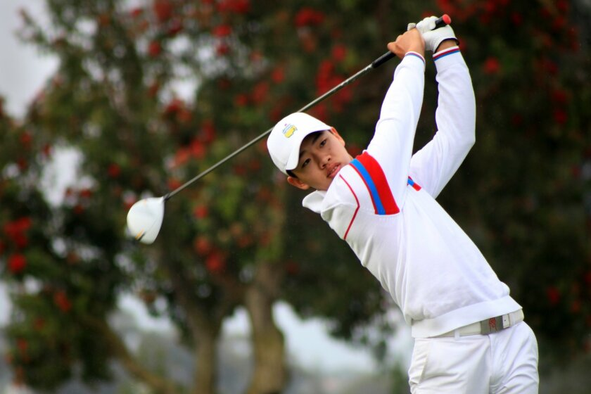 Torrey Pines, CA_7/12/13_Junior World Media Day Guan Tianlang, 14, of China tees off at the 18th hole at Torrey Pines South Golf Course Friday during Media Day for the Callaway Golf Junior World Championship. Misael Virgen/UT San Diego