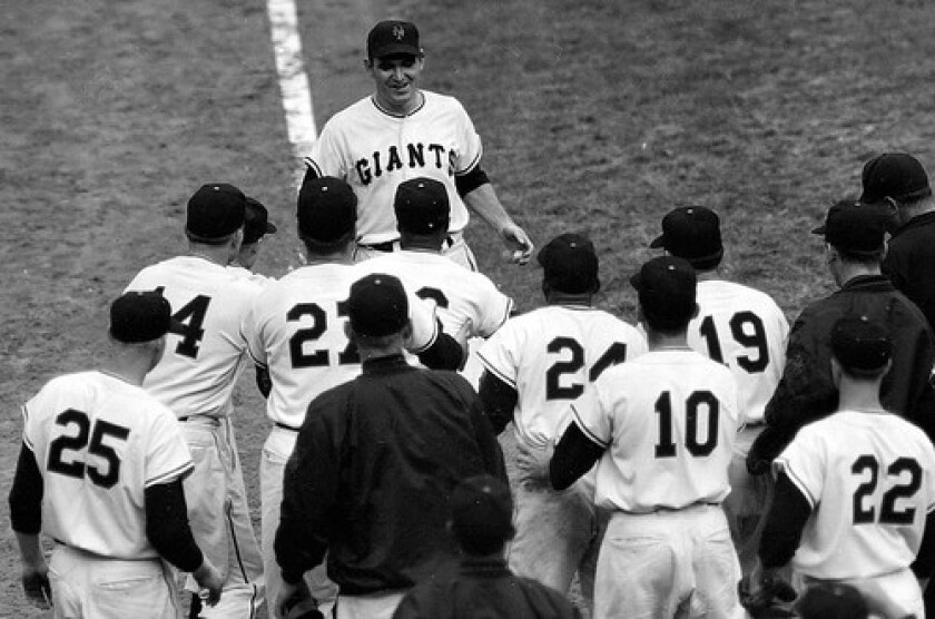 Teammates converge on Dusty Rhodes after he hit a game-winning pinch-hit home run for the New York Giants in the 10th inning of Game 1 of the 1954 World Series.