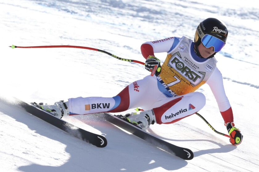 Switzerland's Lara Gut-Behrami speeds down the slope during an alpine ski, women's World Cup downhill, in Val di Fassa, Italy, Friday, Feb. 26, 2021. (AP Photo/Alessandro Trovati)