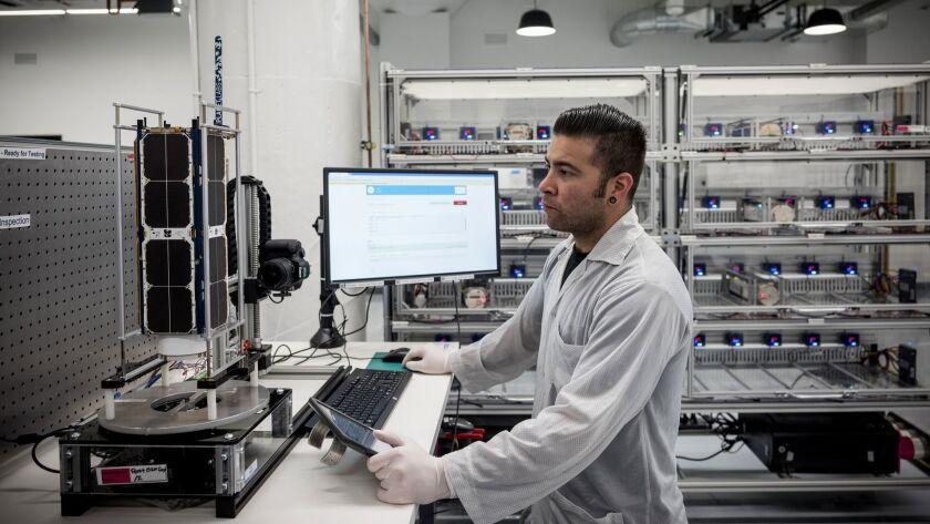 JULY 12, 2018 San Francisco, CA. Technician Raul Perez runs tests on a satellite at the manufacturi