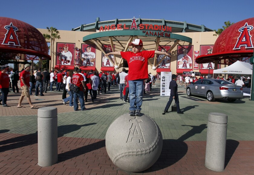 A young fan has some fun before entering Angel Stadium for a game in 2013.