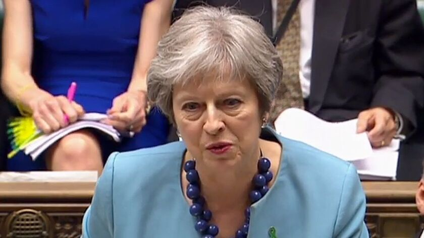 In an image from video broadcast by the Parliamentary Recording Unit, British Prime Minister Theresa May speaks in the House of Commons in London on May 16, 2018.