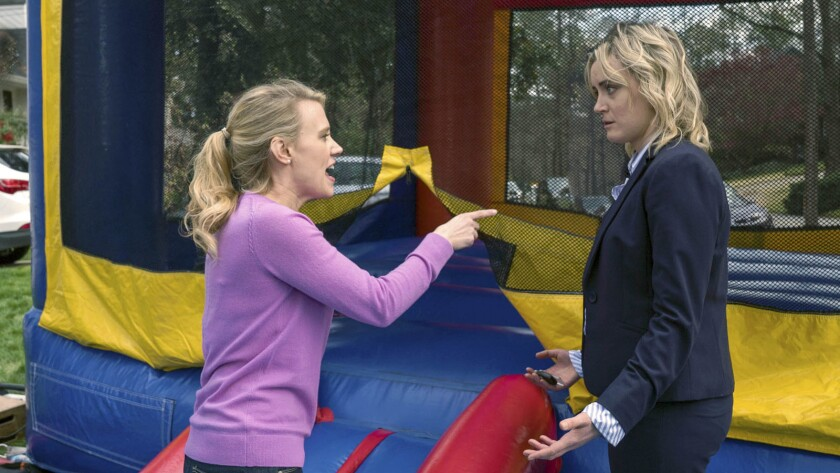 Still photo from the movie, FAMILY. L/R Kate McKinnon and Taylor Schilling, shown. Credit: Sony