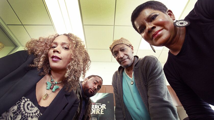 """Actress Rachel True, from left, director Xavier Burgin, actor Tony Todd and executive producer Tananarive Due participated in the documentary """"Horror Noire,"""" a history of black filmmakers/actors in the horror industry."""