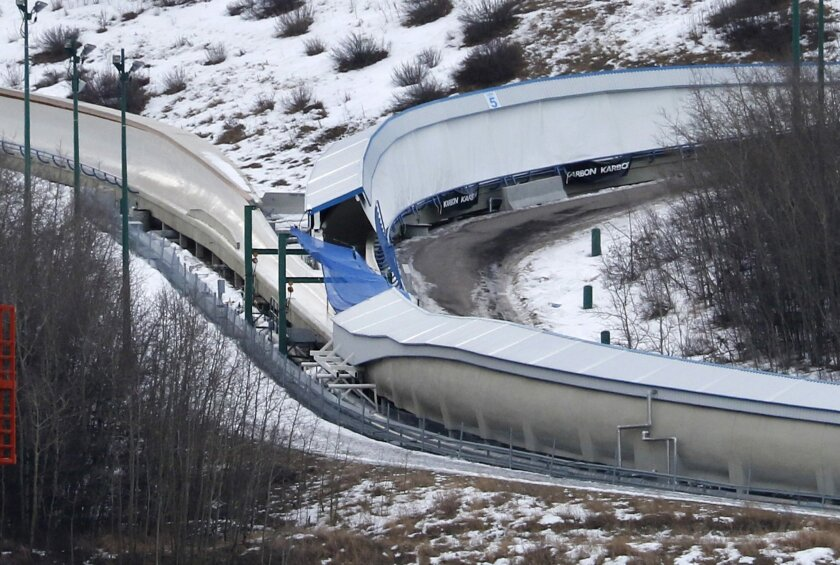 A tarp covers the intersection of the bobsled and luge tracks at Canada Olympic Park in Calgary, Canada, on Saturday, Feb. 6, 2016.  Calgary police say emergency crews were called to the WinSport facility in northwest Calgary early in the morning after a report of several injured people on a closed