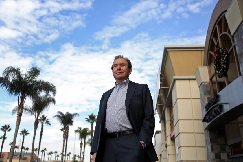 Fred Sands outside the SouthBay Pavilion Mall, one of the many shopping centers he acquired.