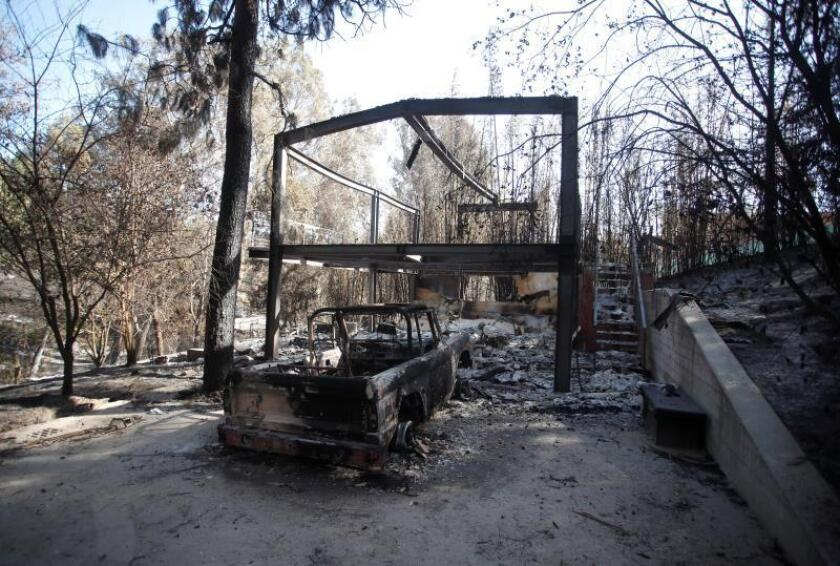 The home of Scottish actor Gerard Butler lies in ruins after being destroyed by the Woosley Fire in Malibu, California, USA, 12 November 2018. Fires across California fueled by very dry conditions and warm, strong Santa Ana winds have destroyed hundreds of homes, caused dozens of fatalities and scorched over 300,000 acres. EPA-EFE/MIKE NELSON