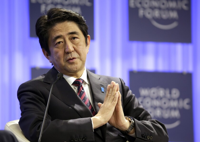 Japanese Prime Minister Shinzo Abe brought the conflict among Asian neighbors over East and South China Sea resources to the World Economic Forum at Davos on Wednesday, when he made veiled criticism of China's increased defense spending and muscle-flexing in the region.