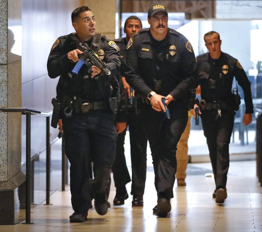 San Diego police officers enter the Westin San Diego Hotel in downtown San Diego on Aug. 17, 2019.