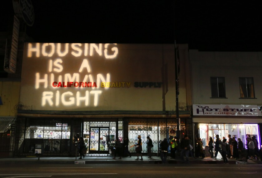 Protesters gathered in Highland Park in December to voice their opposition to landlords who are forcibly evicting tenants so they can refurbish buildings and cash in on the rental boom happening there.