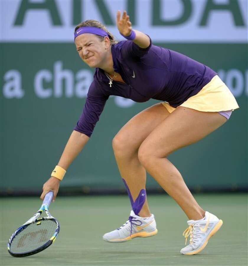 Victoria Azarenka, of Belarus, winces after returning a shot to Urszula Radwanska, of Poland, during their match at the BNP Paribas Open tennis tournament, Tuesday, March 12, 2013, in Indian Wells, Calif. (AP Photo/Mark J. Terrill)