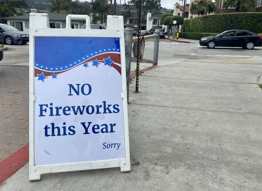 A sign at Kellogg Park in La Jolla Shores on July 3 confirms the La Jolla fireworks show will not go on.