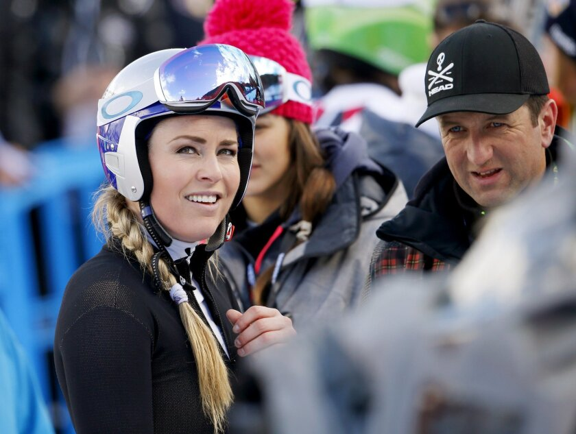 United States' Lindsey Vonn looks up at the finish area after crashing during a women's Alpine ski downhill race, in La Thuile, Italy, Friday, Feb. 19, 2016. (AP Photo/Alessandro Trovati)