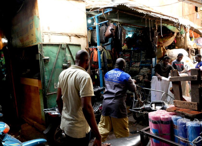 Trader Ibrahim TraorÈ walks through Dabanani market in central Bamako, Mali.