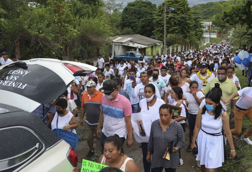 The hearse carrying the remains of Alexander Martinez is followed by a multitude of family and friends during his funeral in Acatlan de Perez Figueroa, Mexico, Thursday, June 11, 2020. Hundreds of residents of this town in southern Mexico bid farewell amid anger and tears to Alexander Martinez, a 16-year-old Mexican-American boy shot dead by local police. (AP Photo/Felix Marquez)