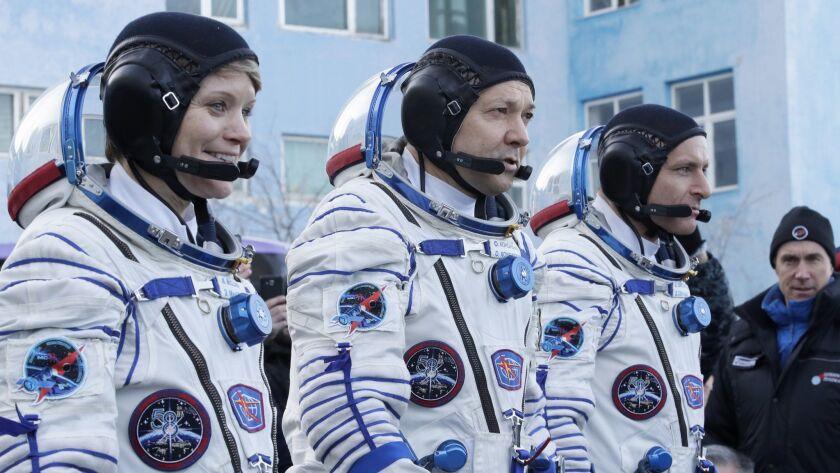 U.S. astronaut Anne McClain, left, Russian cosmonaut Oleg Kononenko and Canadian astronaut David Saint Jacques at the Baikonur cosmodrome in Kazakhstan on Monday.