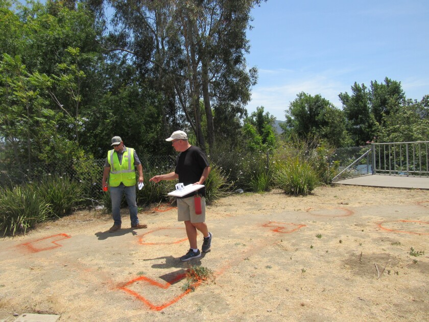 Santee City Councilman Dustin Trotter (left) and designer Michael Ranson assess where a veterans monument will be.