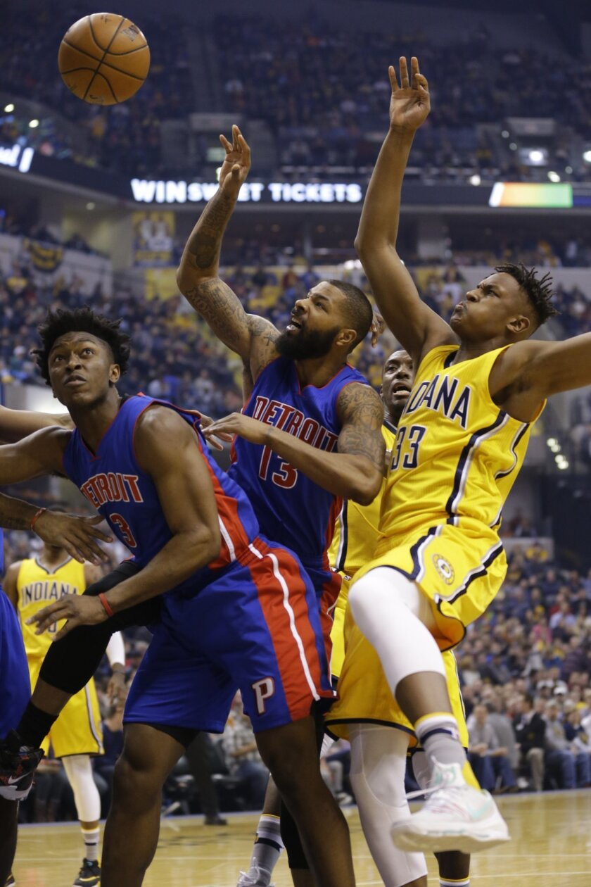 Detroit Pistons forwards Marcus Morris (13) and Stanley Johnson go up for a rebound with Indiana Pacers forward Myles Turner (33) during the first half of an NBA basketball game in Indianapolis, Saturday, Feb. 6, 2016. (AP Photo/Michael Conroy)