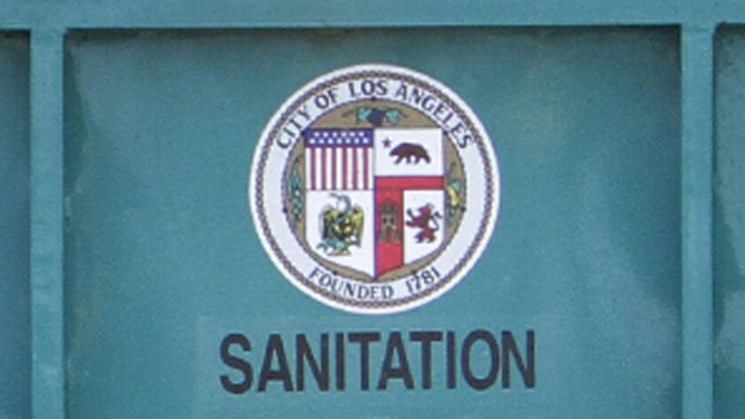The city seal on the back of a Bureau of Sanitation truck.