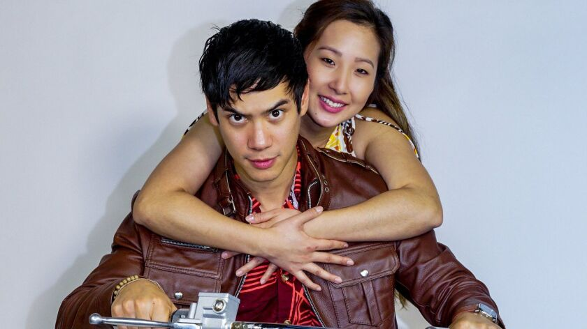 """Ben Levin as Quang and Katherine Ko as Tong in San Diego Rep's """"Vietgone."""""""