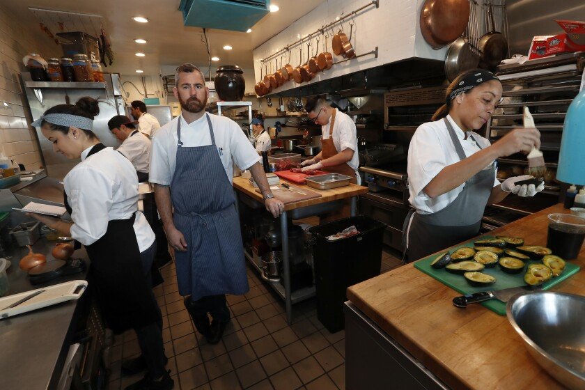 Chef Kevin Meehan inside the kitchen of his restaurant, Kali.