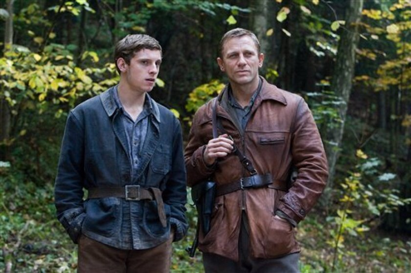 """In this image released by Paramount Vantage, Jamie Bell, left, and Daniel Craig are shown in a scene from, """"Defiance."""" (AP Photo/Paramount Vantage, Karen Ballard)"""