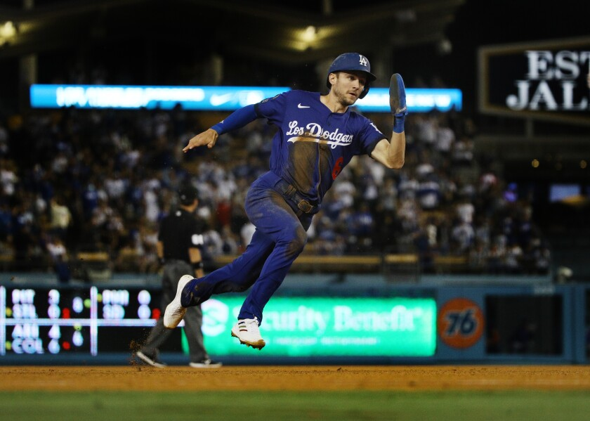 Dodgers second baseman Trea Turner speeds around the bases to score from first base on an RBI double.