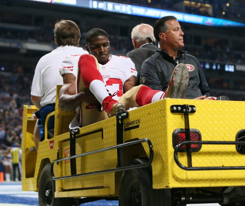 San Francisco 49ers running back Reggie Bush is carted off the field after being injured during an NFL football game against the St. Louis Rams, Sunday, Nov. 1, 2015, in St. Louis. (Chris Lee/St. Louis Post-Dispatch via AP)  EDWARDSVILLE INTELLIGENCER OUT; THE ALTON TELEGRAPH OUT; MANDATORY CREDIT
