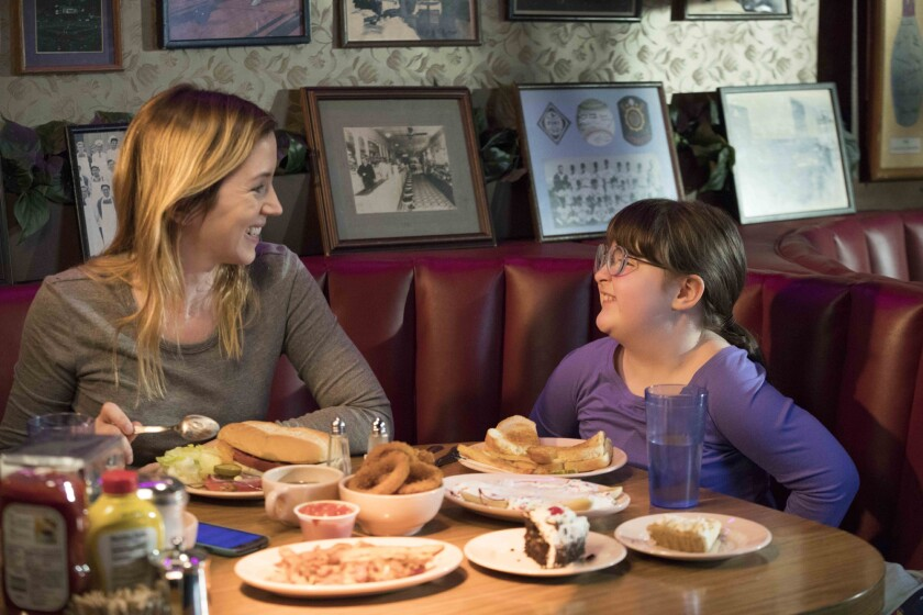 """Stephanie Turner and Daisy Prescott share a meal in the movie """"Justine."""""""