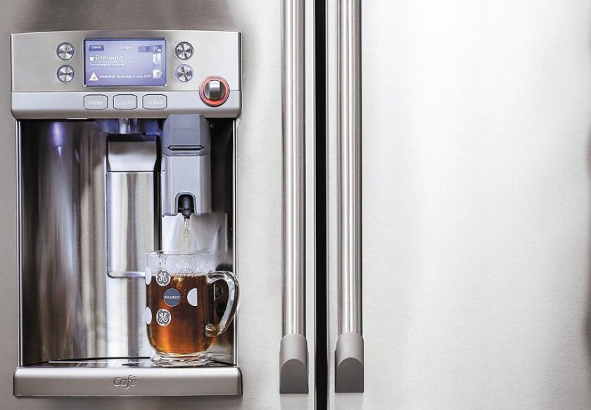 GE's new refrigerator dispenses coffee, as well as water and ice.