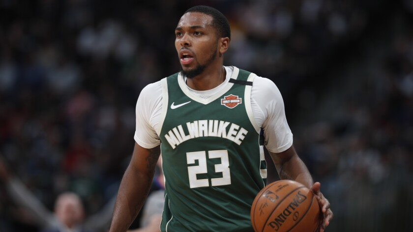 Bucks guard Sterling Brown brings the ball up court during a game against the Nuggets on March 9, 2020, in Denver.