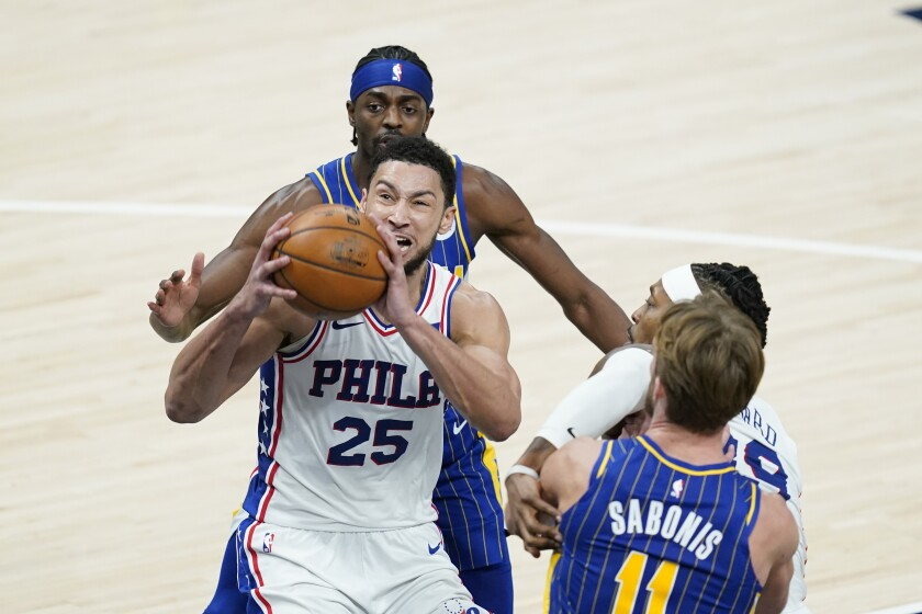 Philadelphia 76ers' Ben Simmons (25) goes up for a dunk during the second half of an NBA basketball game against the Indiana Pacers, Sunday, Jan. 31, 2021, in Indianapolis. (AP Photo/Darron Cummings)