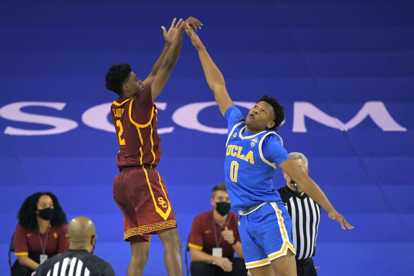USC's Tahj Eaddy makes the game-winning shot over UCLA's Jaylen Clark on Saturday at Pauley Pavilion.