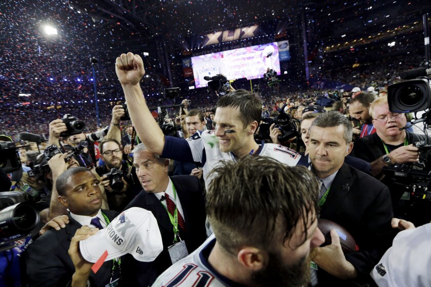 New England quarterback Tom Brady celebrates after the Patriots won Super Bowl XLIX at University of Phoenix Stadium in Glendale, Ariz., on Feb. 1.